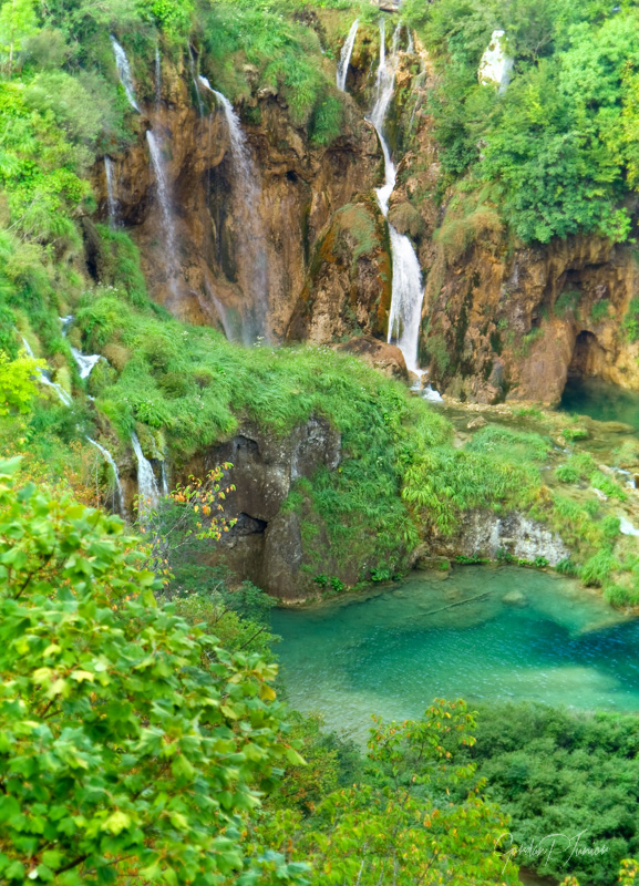 Beautiful green waterfall at Plitvice Lakes National Park , UNESCO World Heritage Center. Soft focus photo